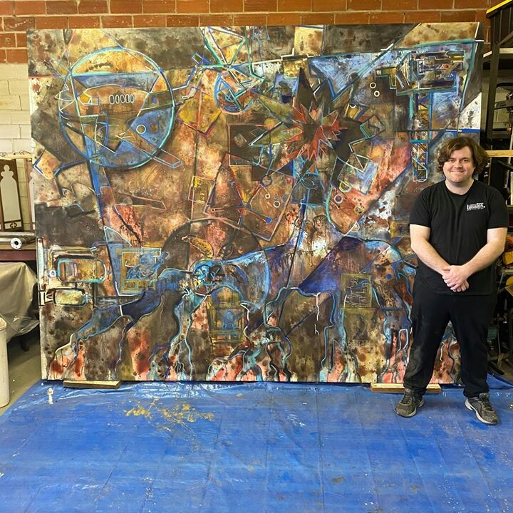 jason-with-commission-painting-in-2020