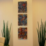 Art sketches hanging in a client's board room