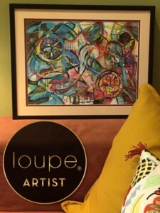 Art hanging on a wall with the Loupe Art badge